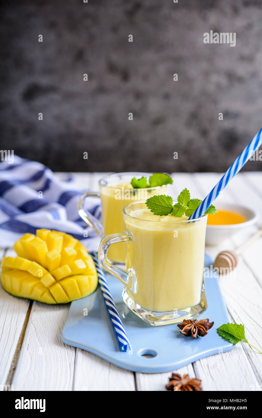 Mango Lassi - traditional Indian yoghurt drink in a glass jars Stock Photo