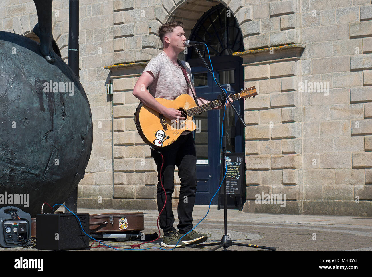 teenage busker in the cornish city of truro, cornwall, england, britain, uk. - Stock Image