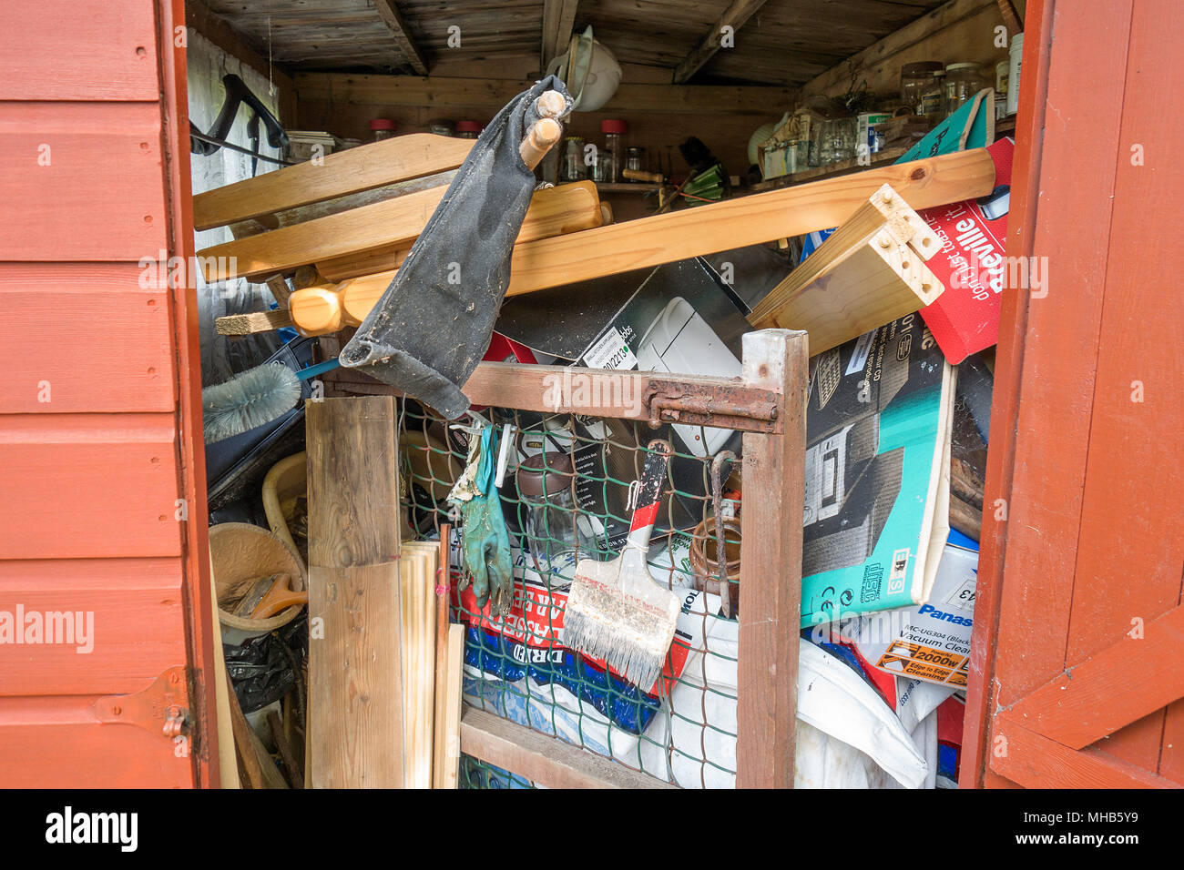 garden shed full packed tools household items junk. - Stock Image