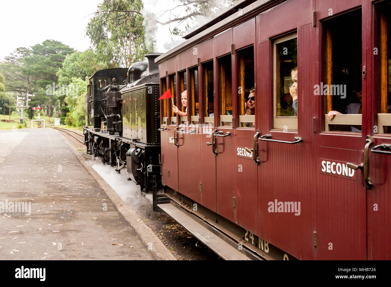 Melbourne, Australia. Puffing Billy steam train with passengers. Historical narrow railway in the Dandenong Ranges near Melbourne. - Stock Image