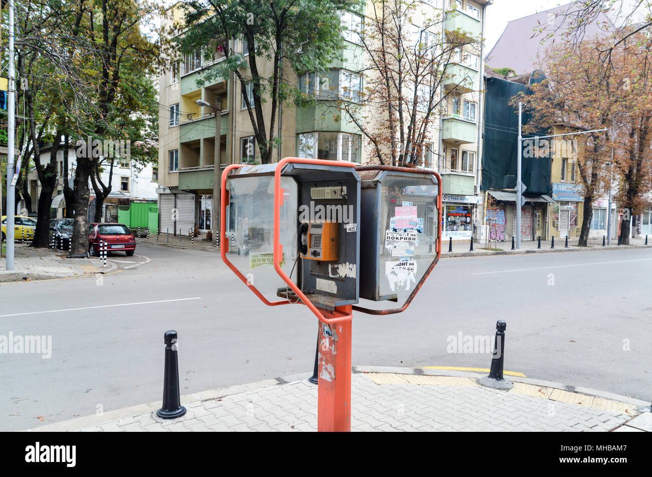 Street life in Sofia, woman on a phone, Bulgaria Stock Photo