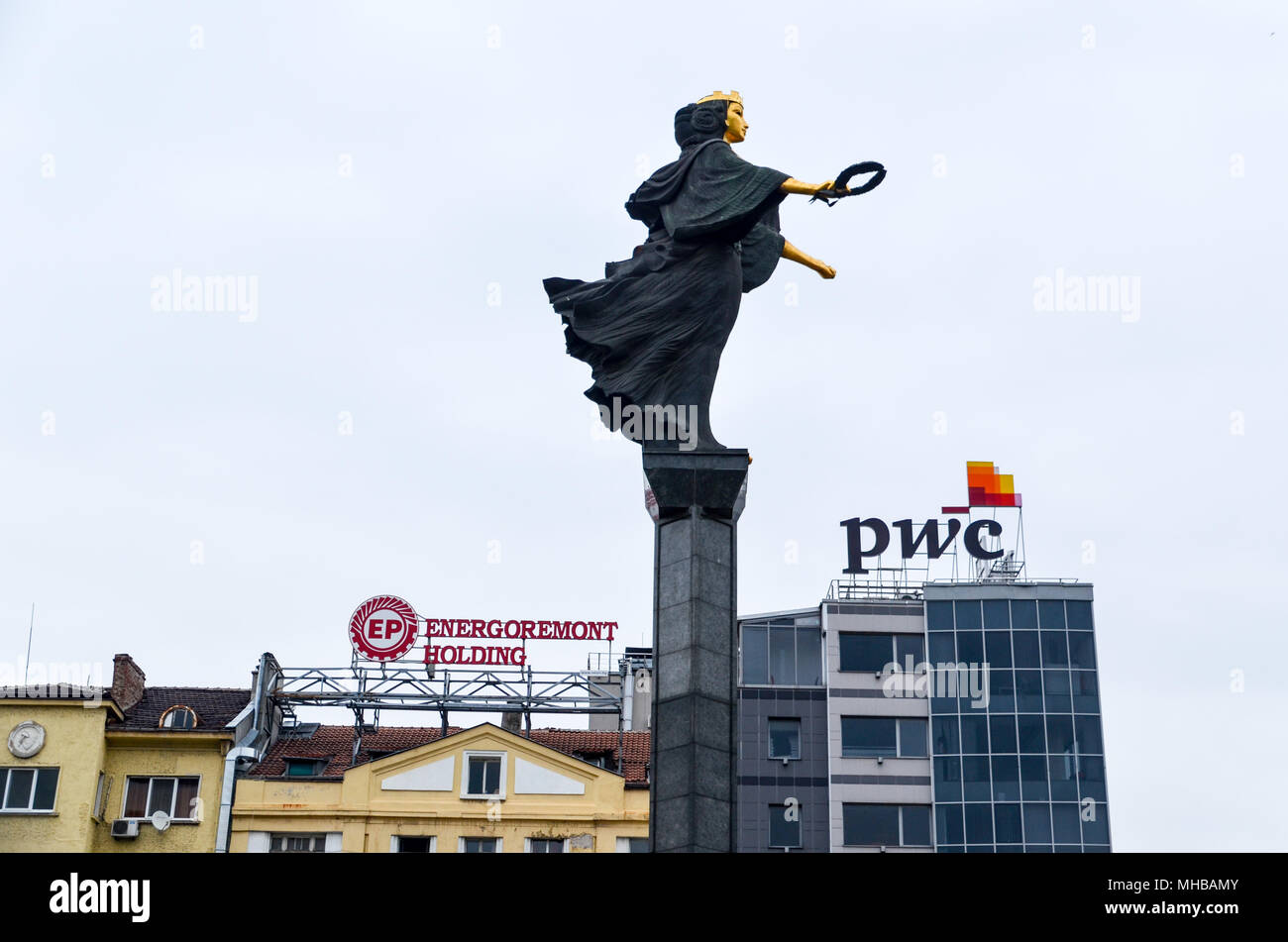 Sveta Sofia statue in Serdika, Sofia, Bulgaria, with the PWC building in the background - Stock Image
