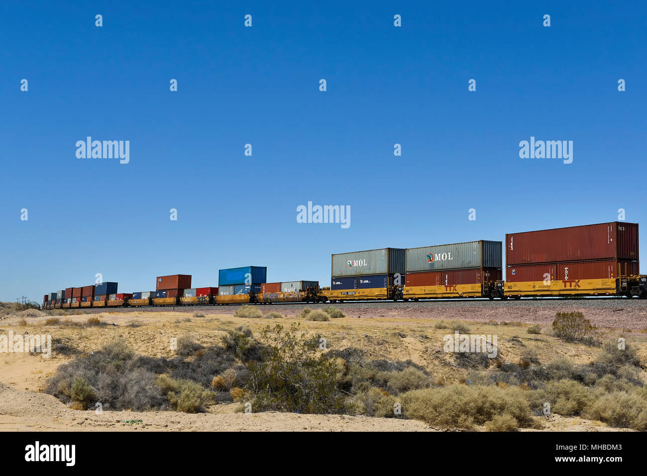 Container Boxes on a freight train in Barstow, California - Stock Image