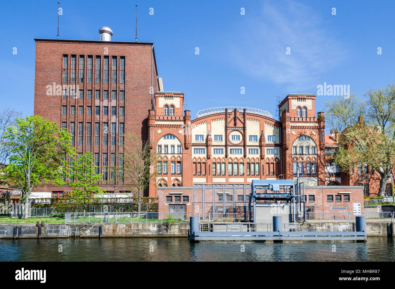 Berlin, Germany - April 22, 2018: Brick Gothic historic machine hall of the cogeneration plant Charlottenburg as seen from the river Spree - Stock Image