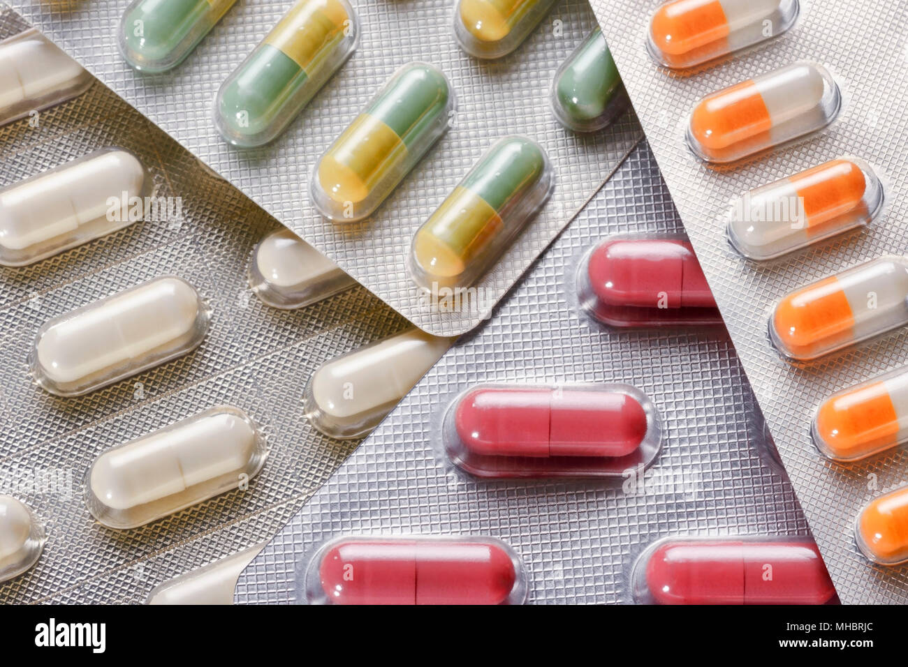 Various coloured pills in blister packs, full frame - Stock Image