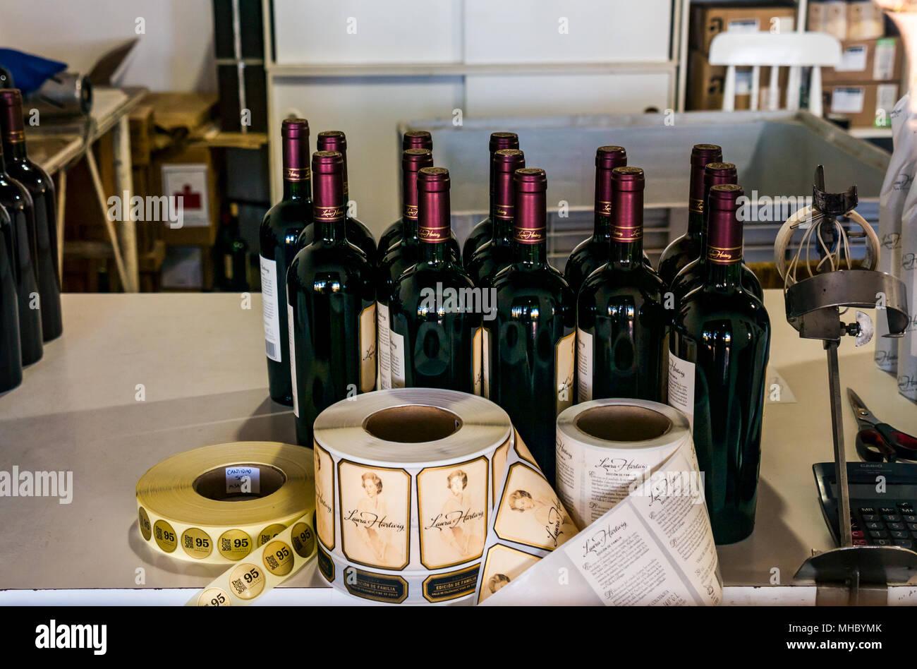 Wine bottle labelling at Laura Hartwig winery, Santa Cruz wine region, Colchagua Valley, Chile, South America - Stock Image