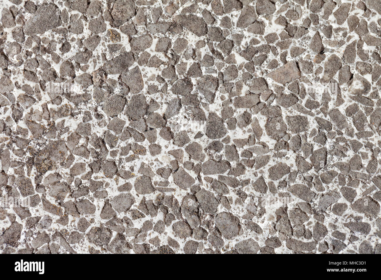 Terrazzo floor texture deteriorated by the use and the passage of time. - Stock Image