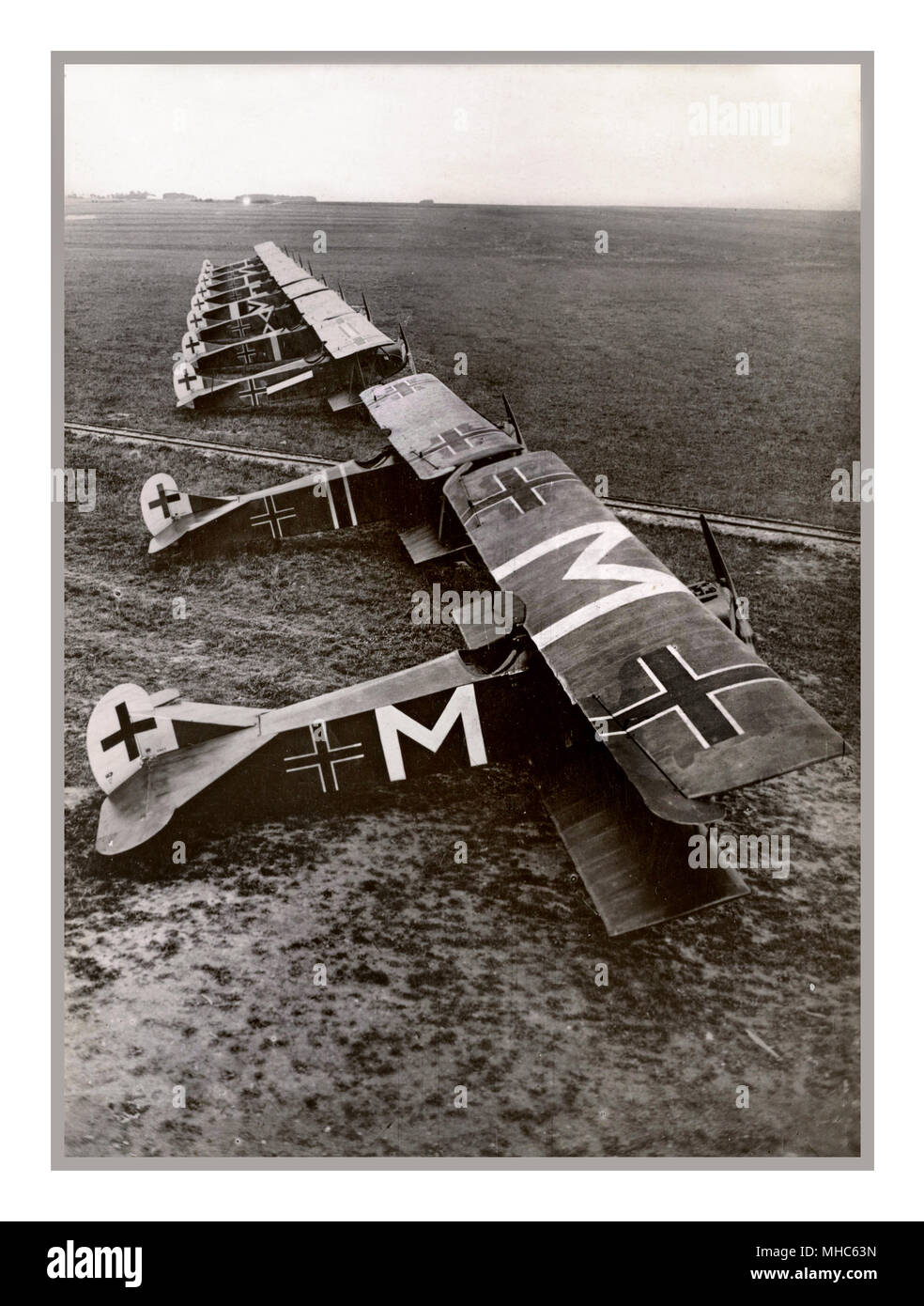 "WW1 Ten German Fokker D.VII aircraft of Jasta 72 at Bergnicourt, France, in July 1918. The plane marked with an ""M"" belonged to Oberleutnant Karl Menckhoff . On 23 April 1918, he was awarded Germany's highest decoration for valor, the Pour le Mérite, his victory total having reached 25.Carl Menckhoff (14 April 1883 – 11 January 1949) was a German First World War fighter ace, credited with 39 confirmed victories. He was one of the oldest pilots in the Imperial German Air Service, he transferred from infantry service to aviation as a non-commissioned officer Stock Photo"