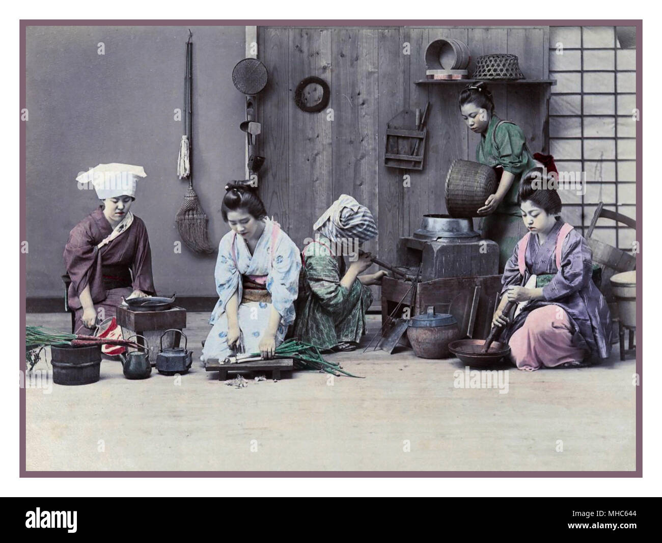 JAPAN Meiji period 1880-1890 female workers in a kitchen prepare for dinner. Colour lithography Photochrom image technique Circa 1880-1890. Meiji period (明治時代, Meiji-jidai), also known as the Meiji era, is a Japanese era which extended from October 23, 1868, to July 30, 1912. This period represents the first half of the Empire of Japan during which Japanese society moved from being an isolated feudal society to its modern form. - Stock Image