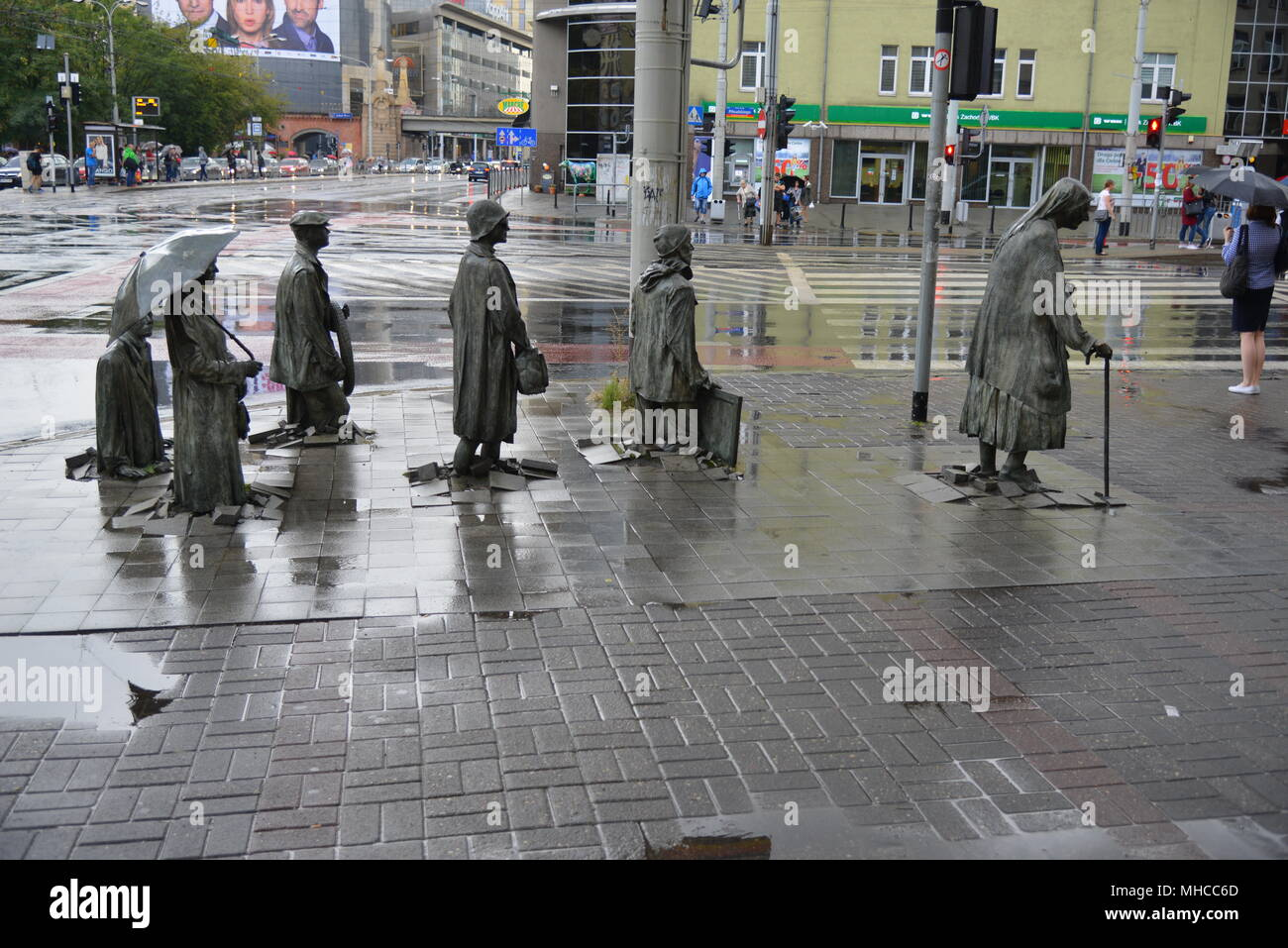 The famous sculpture 'Passage', commonly called 'Monument to the Anonymous Passerby' by Polish artist Jerzy Kalina at an intersection in Wroclaw. - Stock Image
