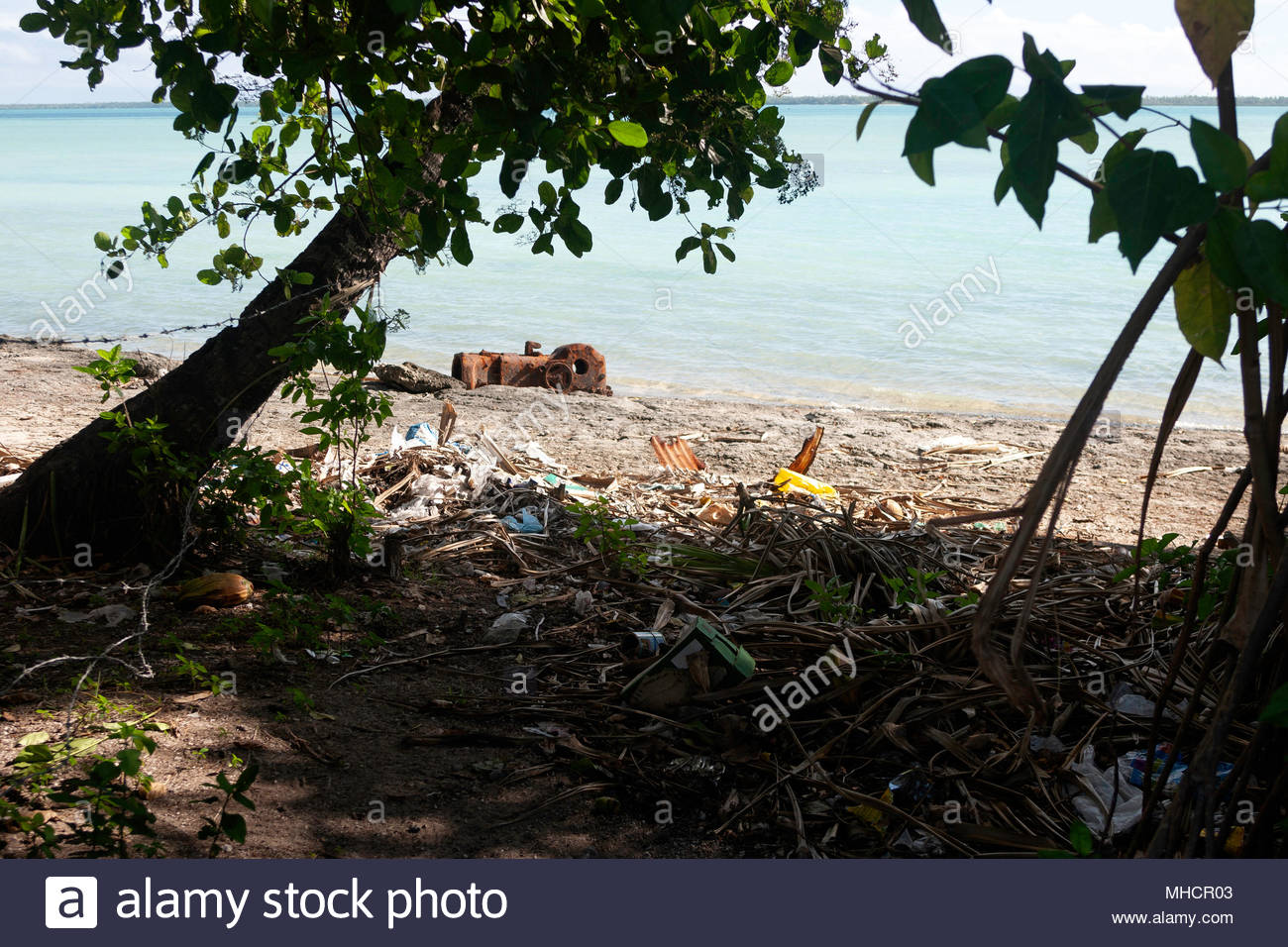 Residual of the WWII and current rubbish at Tarawa beach - Stock Image