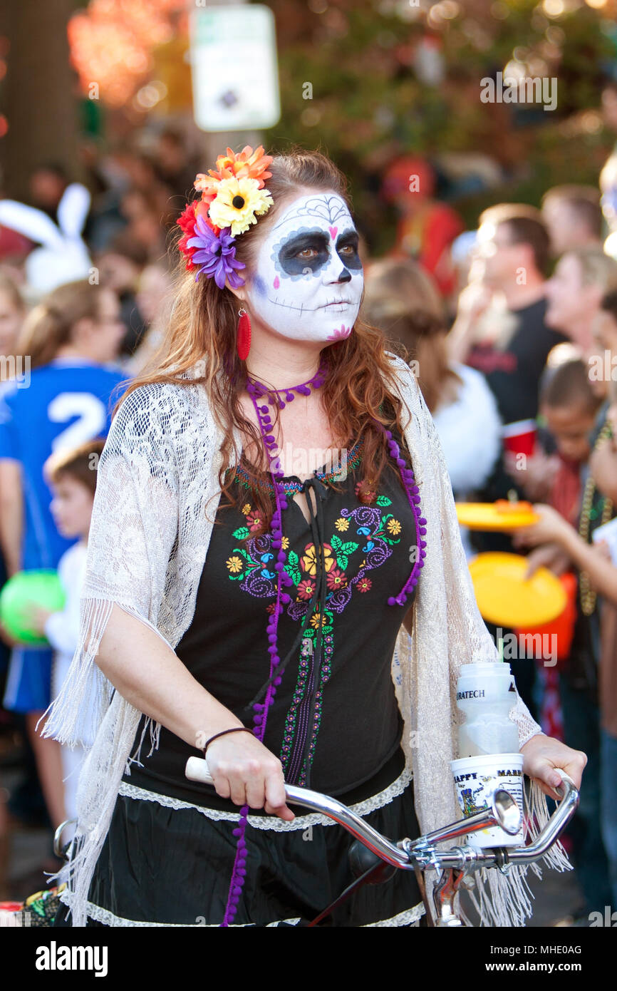 a woman dressed like a hippie zombie rides a bicycle in the little five points halloween parade on october 20 2012 in atlanta ga