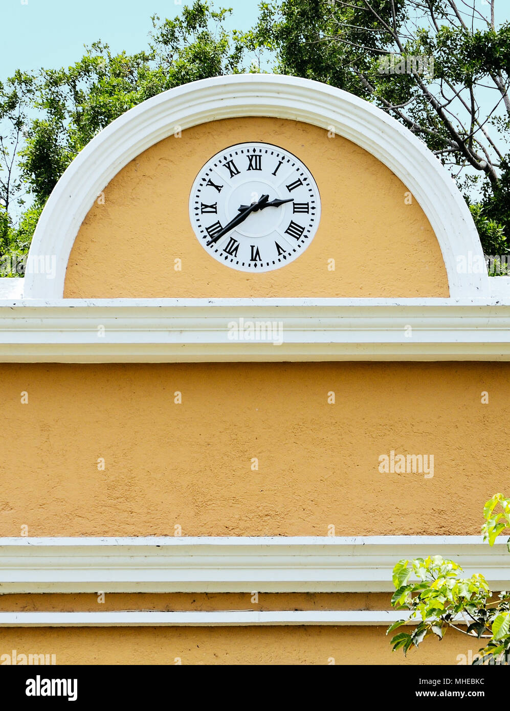 Old clock on the facade of a sugar mill hacienda in Mexico - Stock Image