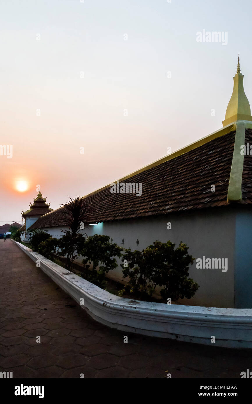 The Pha That Luang at Sunrise. Svelte and golden the Pha That Luang is the most important national monument in Laos. - Stock Image