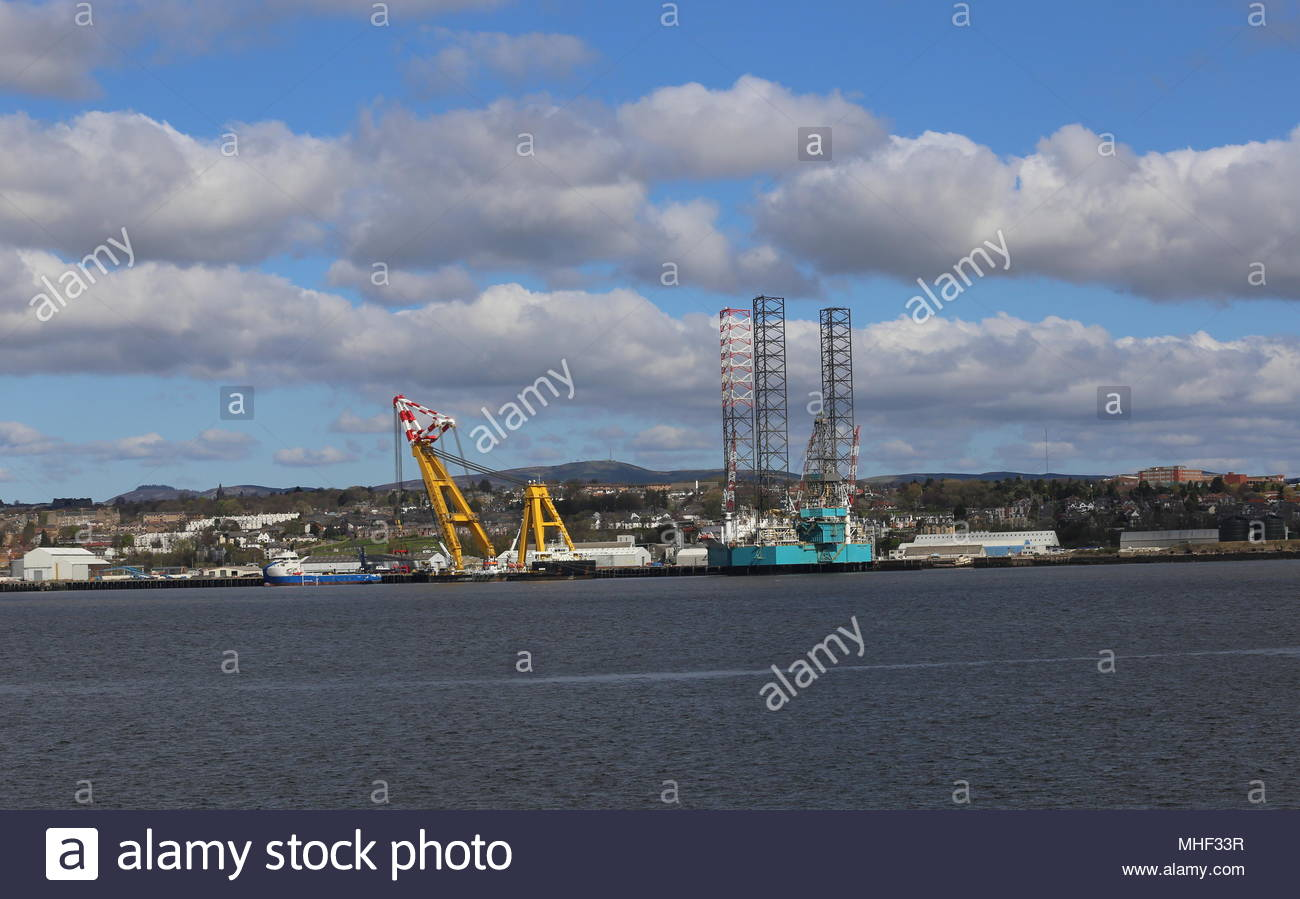 Oil rig Rowan Norway and heavy lift crane Asian Hercules 3 at Port of Dundee Scotland  April 2018 - Stock Image