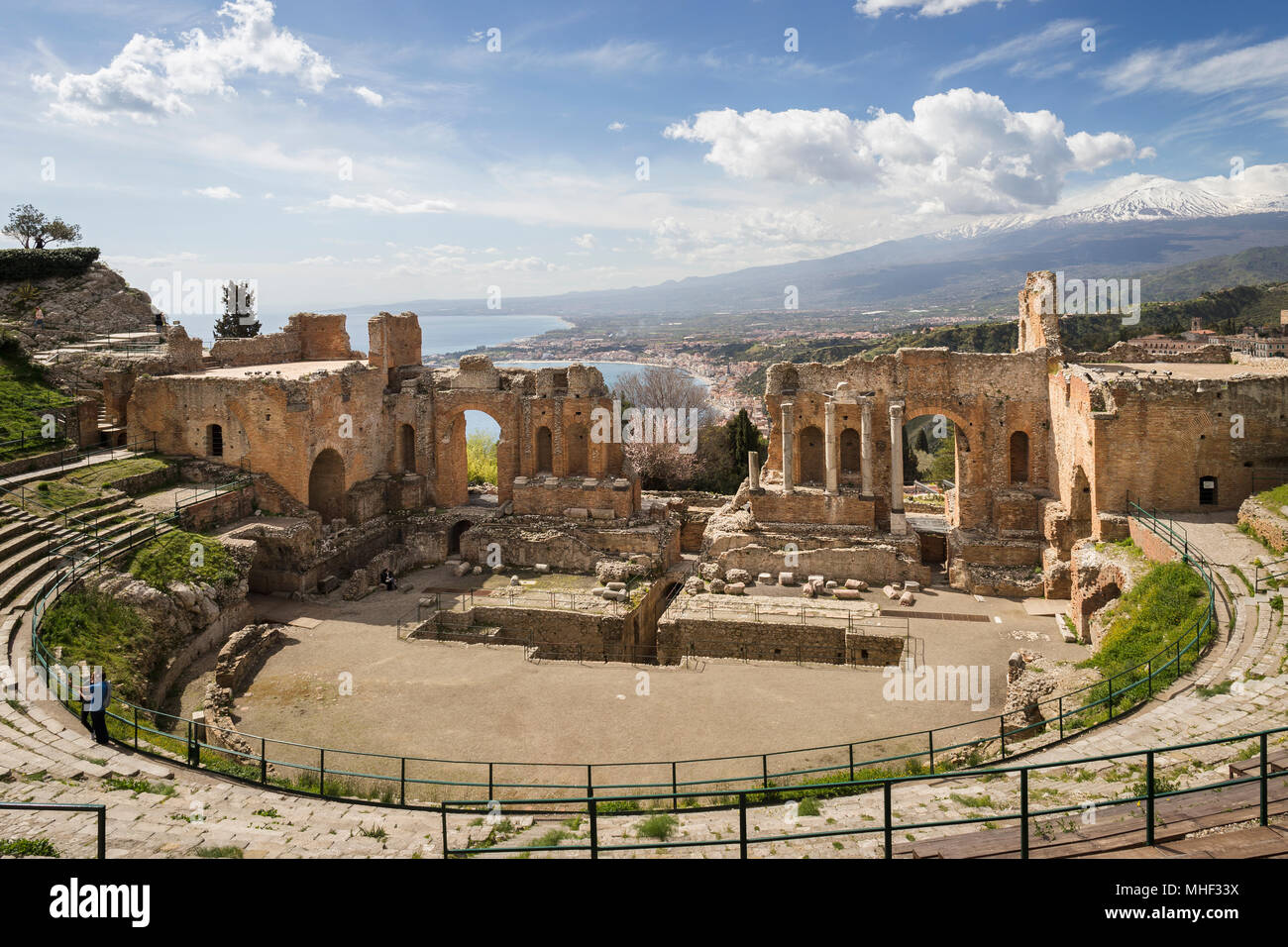 Ancient theatre of Taormina with Mt. Etna, Sicily. - Stock Image