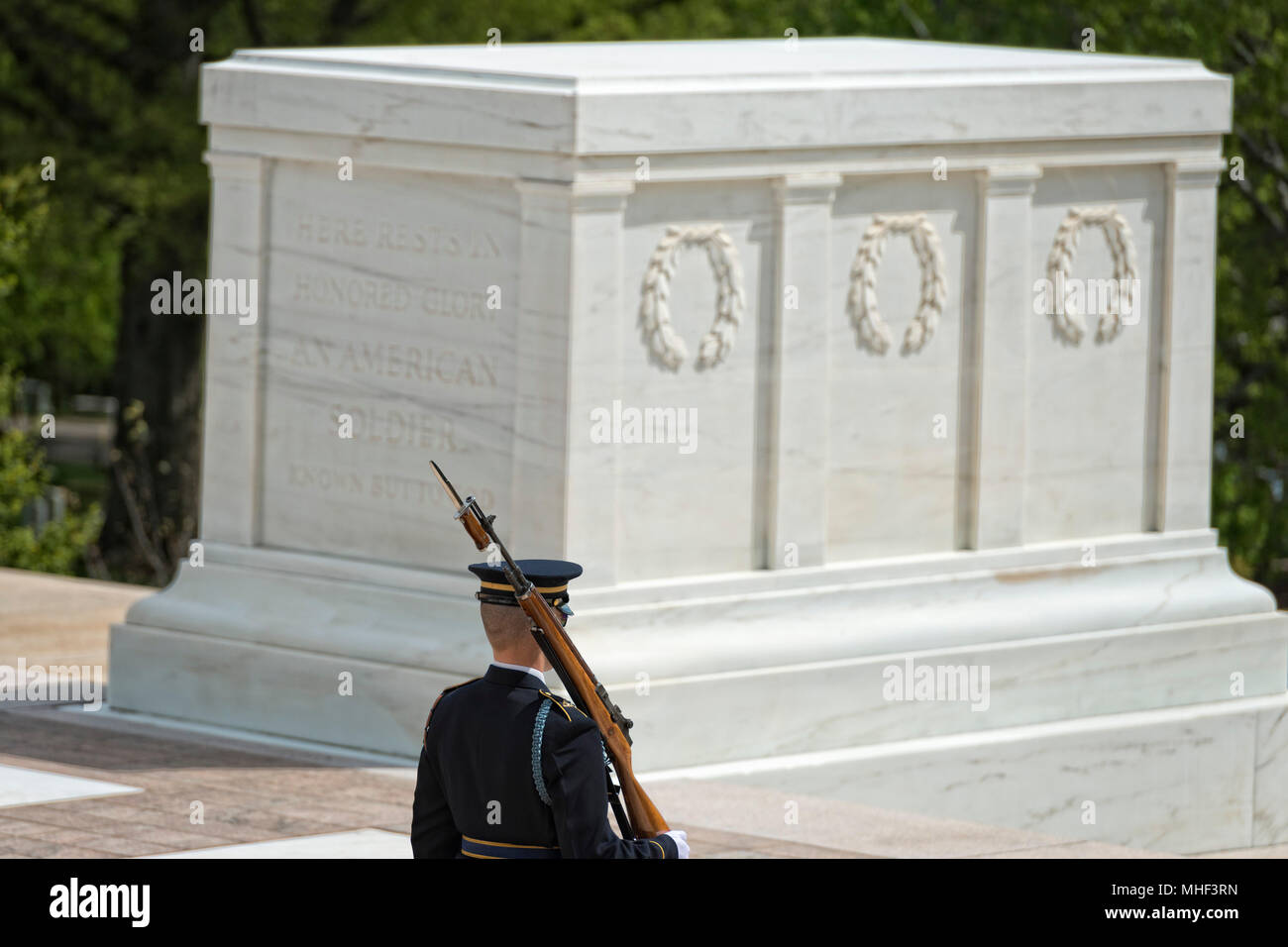 Unknown soldier monument in Arlington Cemetery Washington DC with the honor guard - Stock Image