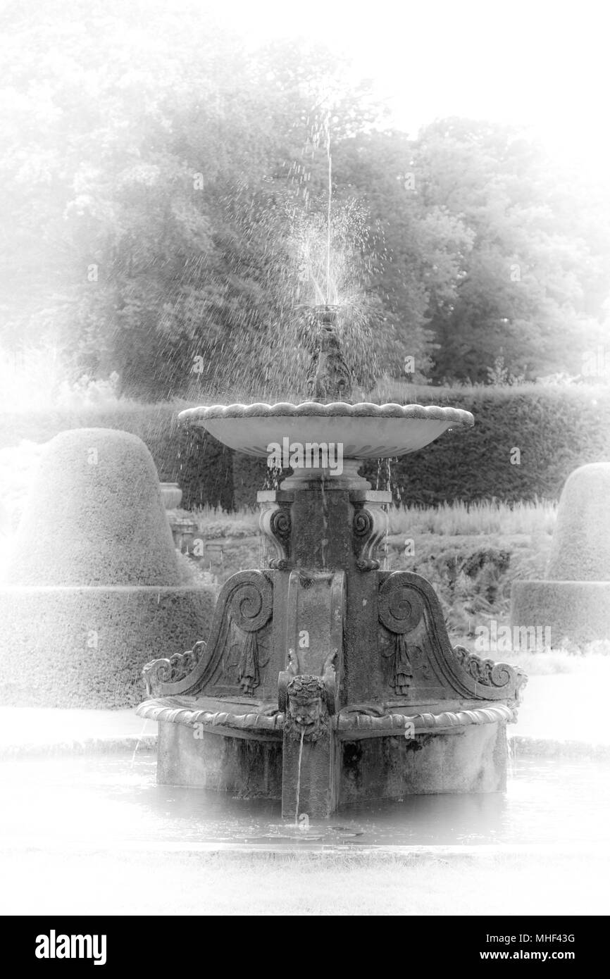 Black and White Arty shot of an old fountain. Antique look - Stock Image