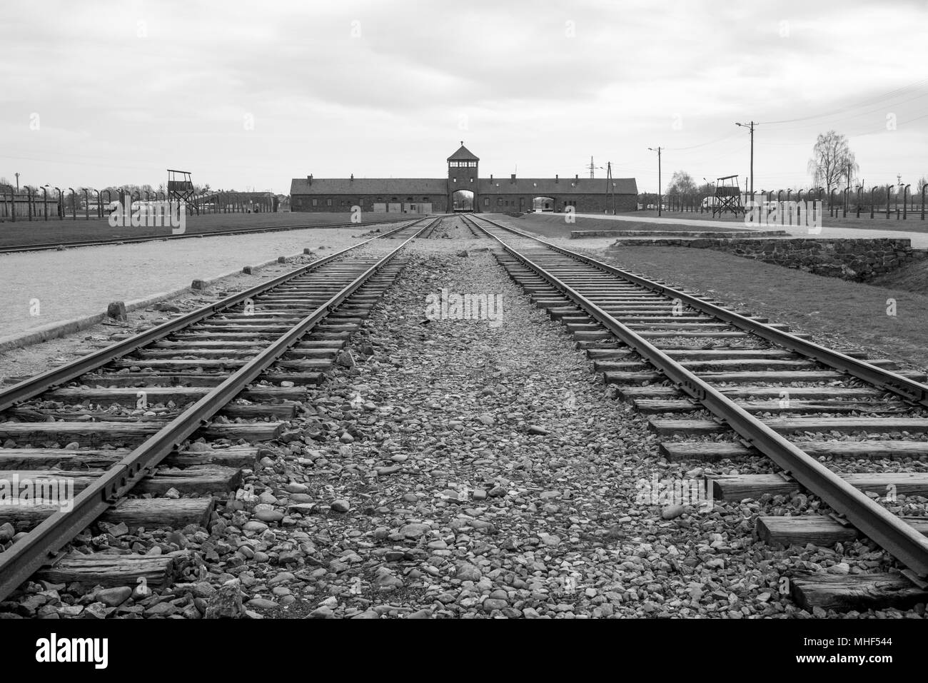 Entrance to Auschwitz Birkenau (Poland) Nazi Concentration Camp showing train tracks used to bring Jews and other minority groups to the gas chambers. - Stock Image