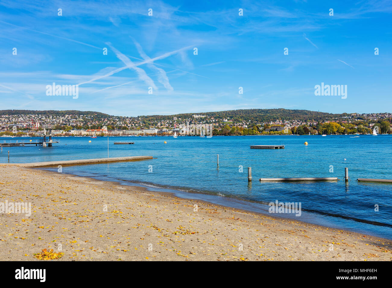 Lake Zurich in Switzerland at the beginning of October, buildings of the city of Zurich in the background. - Stock Image