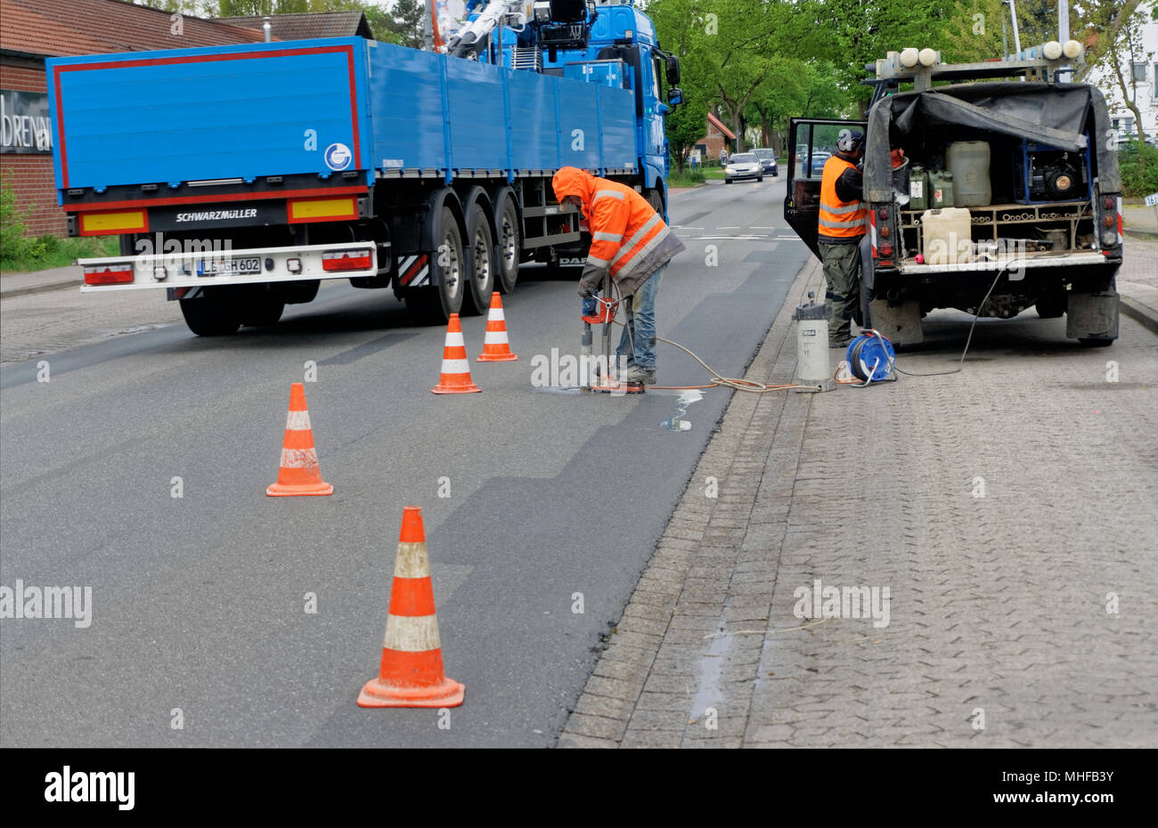 Wolfsburg, Lower Saxony, Germany, April 26, 2018: Closure of a thoroughfare to remove cores from the asphalt surface, road sampling - Stock Image