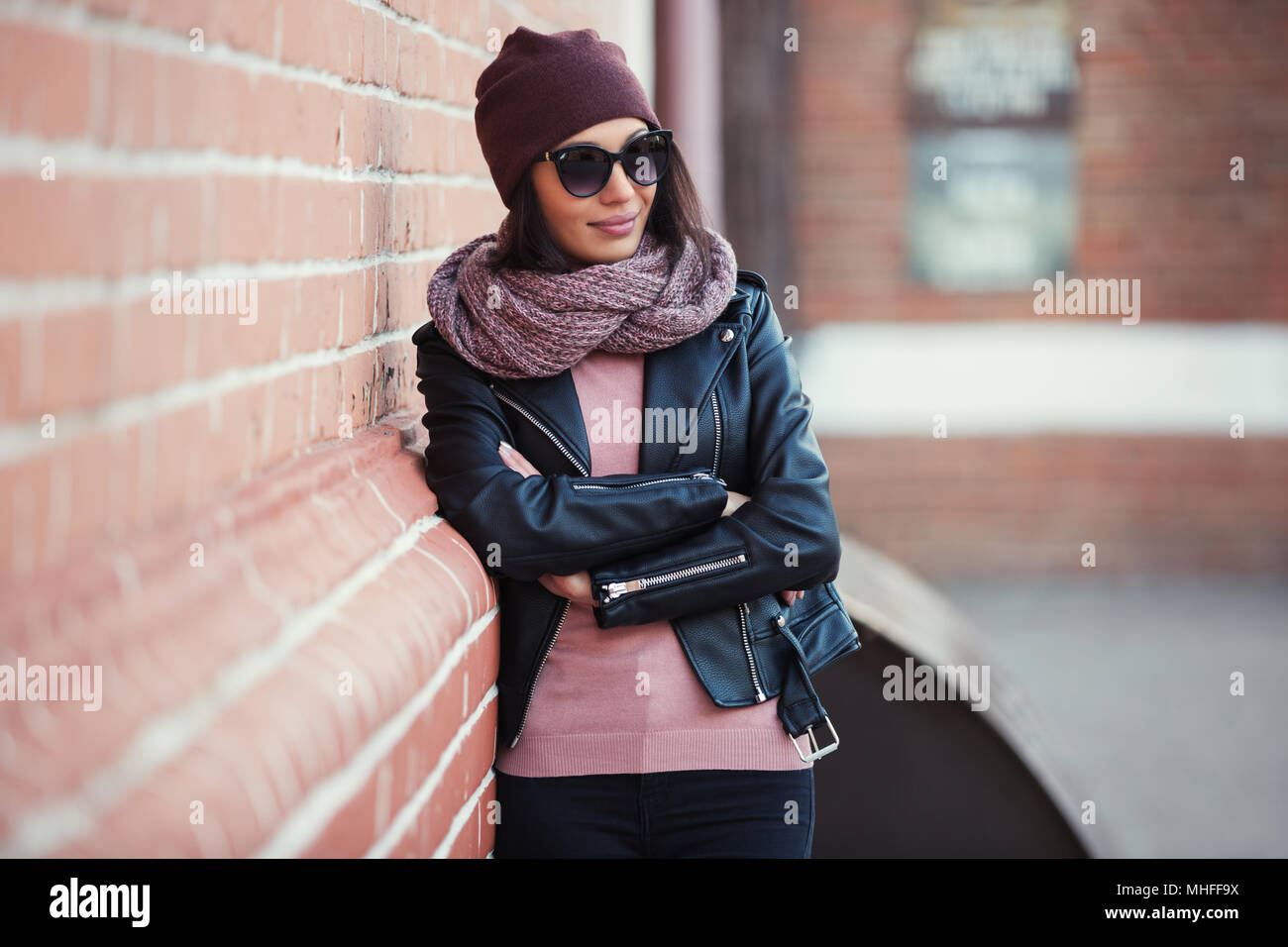 Young Fashion Woman Wearing Sunglasses Scarf And Beanie Leaning On