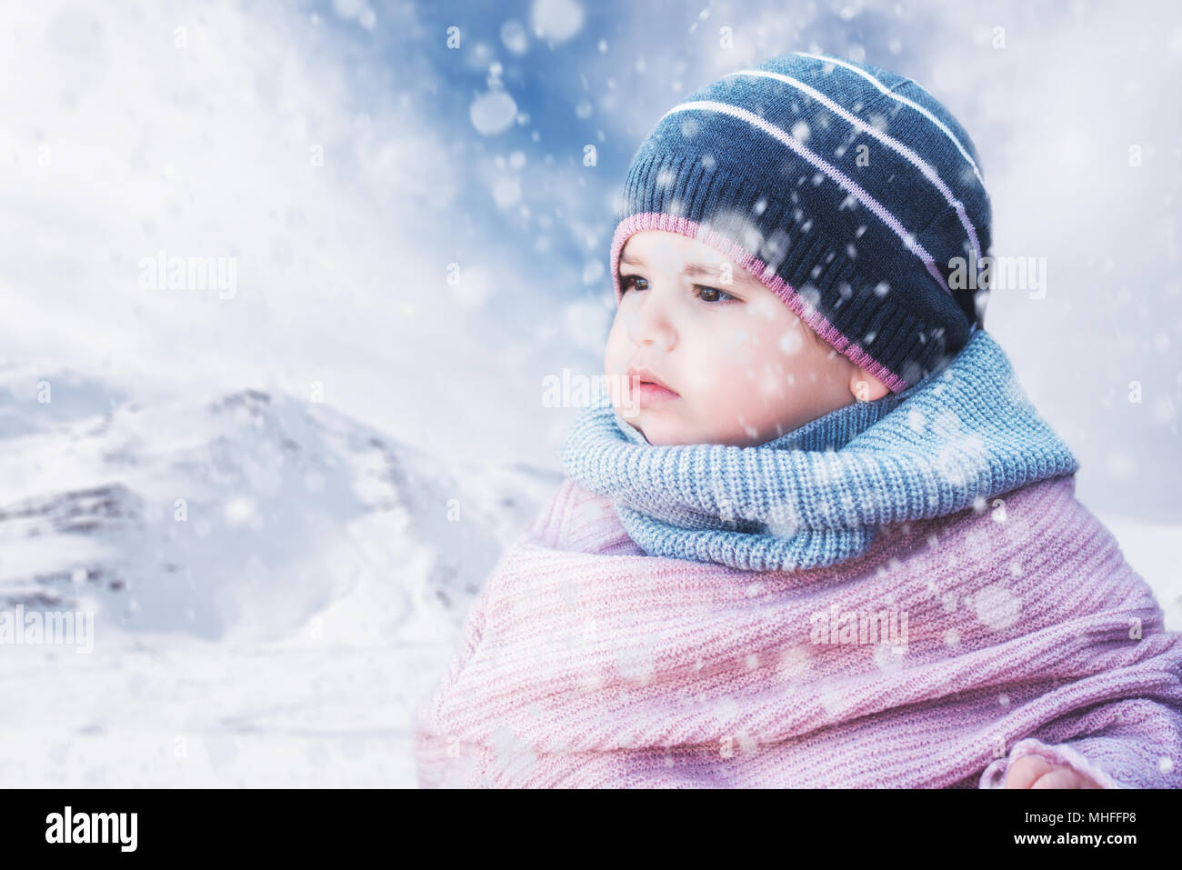 509360c9c Cute baby girl wearing a warm winter hat and a colorful hat on a ...