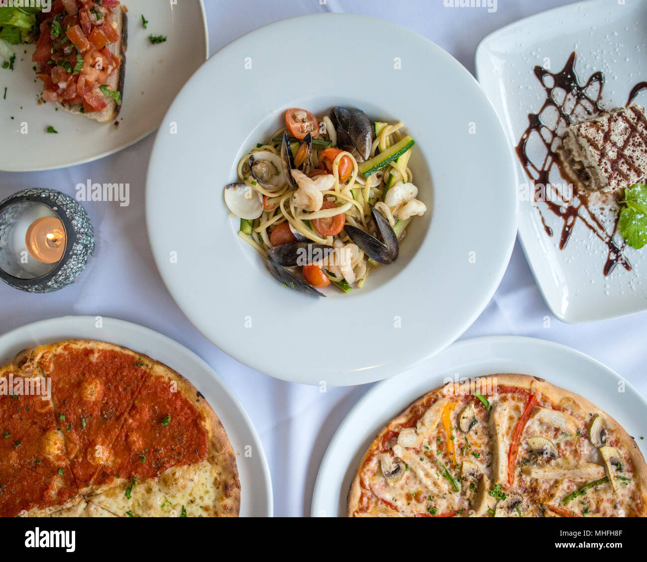 Italian Food in Restaurant Stock Photo