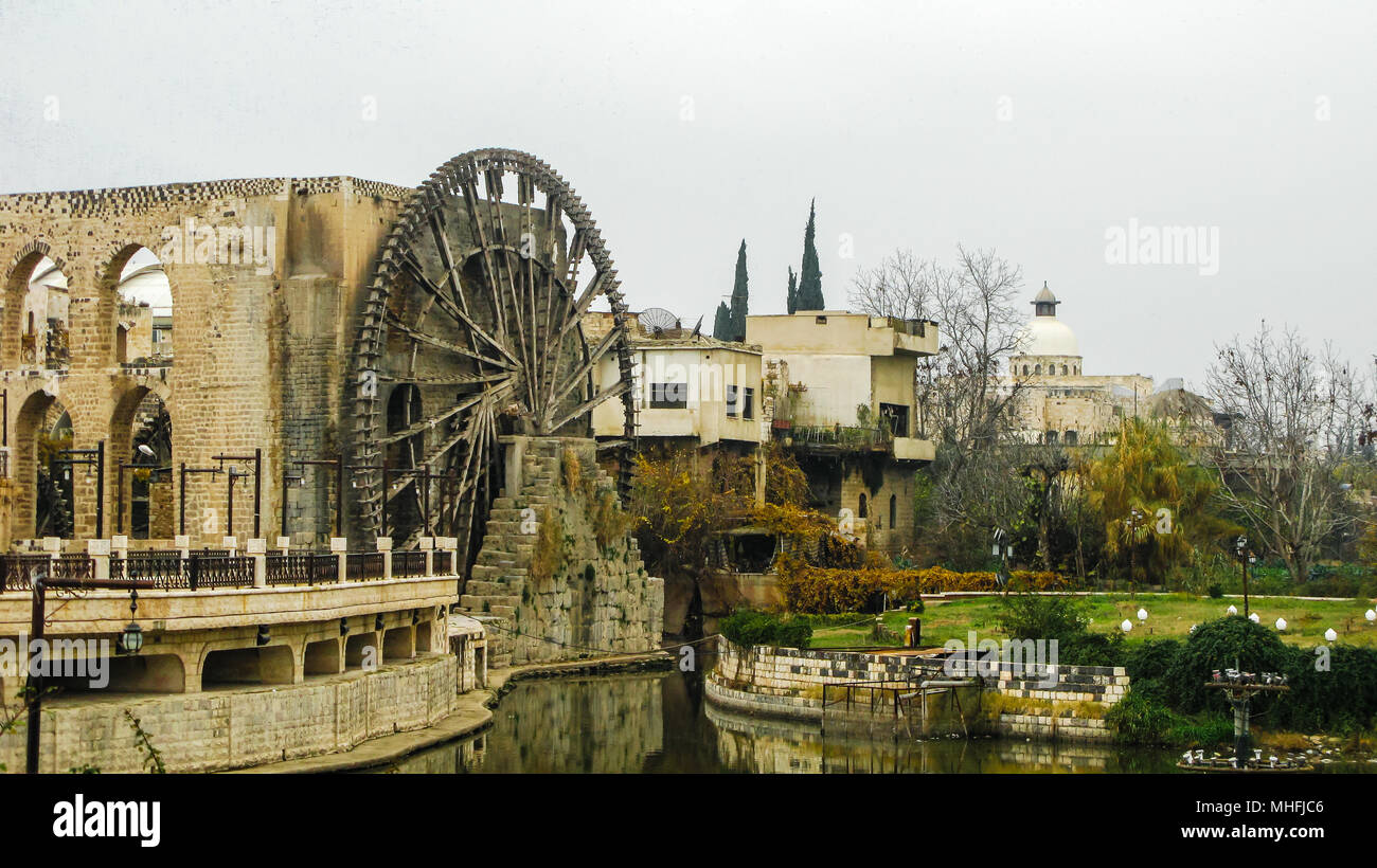 Irrigation Water-wheel norias in Hama on the Orontes river, Syria Stock Photo