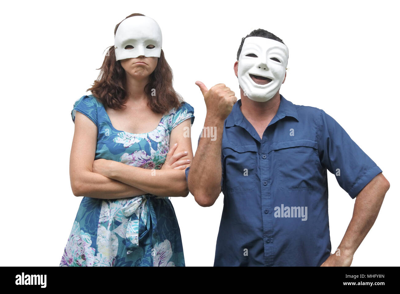 Man wearing a happy face mask laughing at a woman who wearing a sad face mask. Real people. Copy space - Stock Image