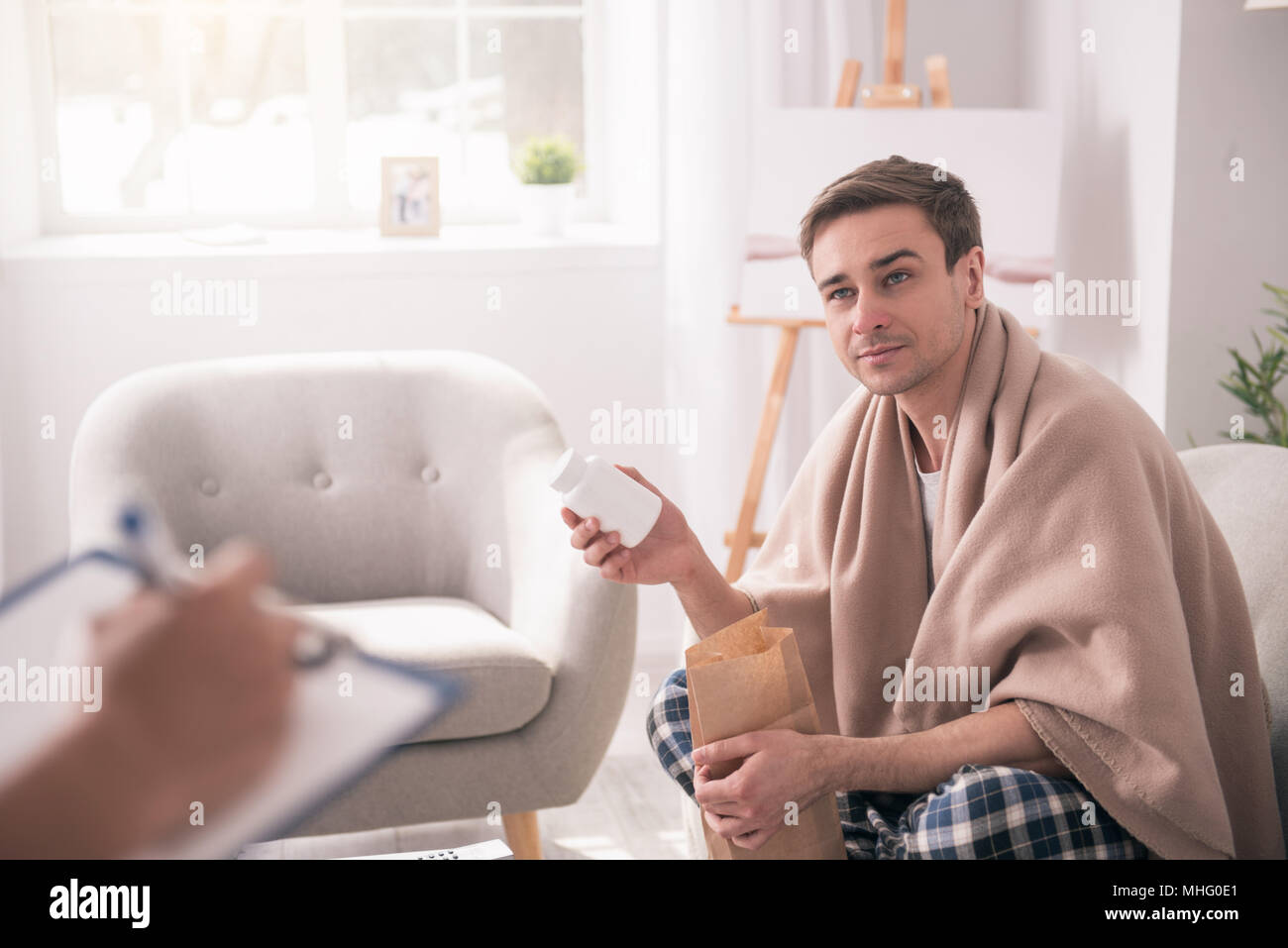 Nice good looking man opening the package - Stock Image