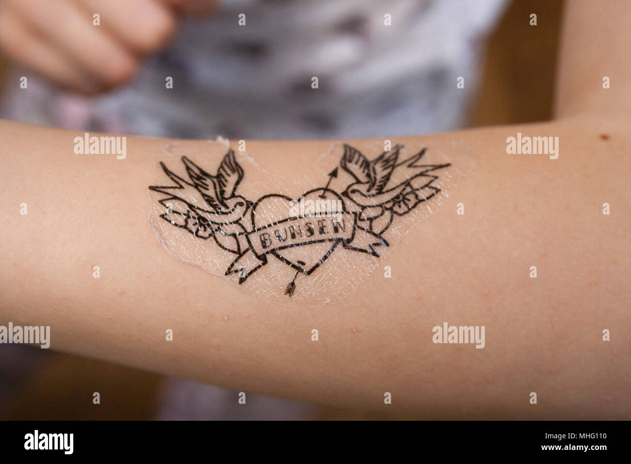 Heart tattoo on a childs, girls, kids arm, painted nails, nail ...