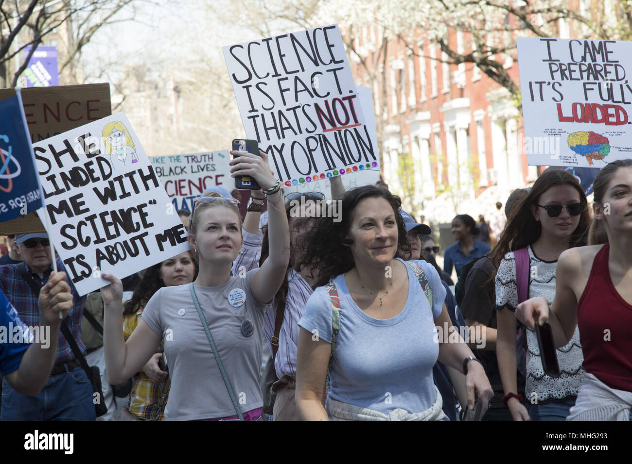 2nd annual March For Science was held in many cities in conjunction with Earth Day.  (New York City) The march is a non-partisan movement to celebrate science and the role it plays in everyday lives. The goals of the marches and rallies are to emphasize that science upholds the common good and to call for evidence-based policy in the public's best interest. - Stock Image