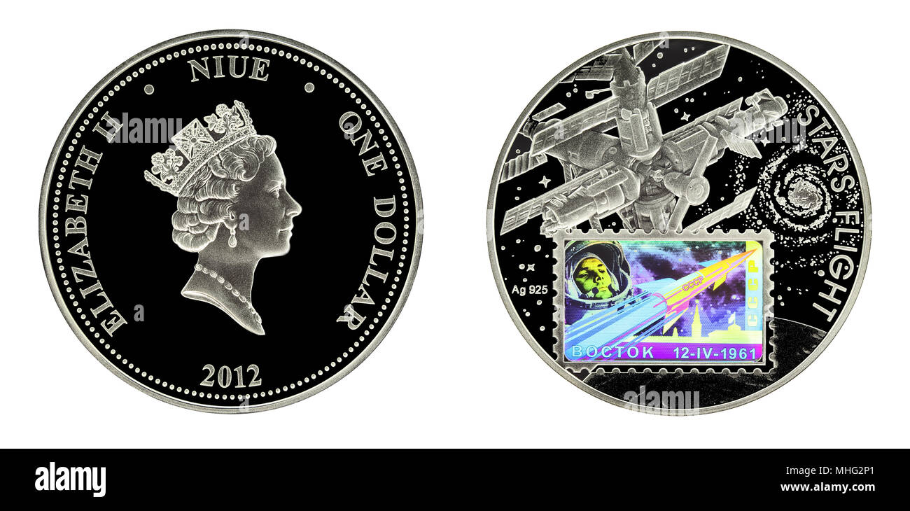 Investing silver coin Niue 1 dollar 2012 Stars Flight Space Hologram Gagarin Stamp Silver booklet - Stock Image