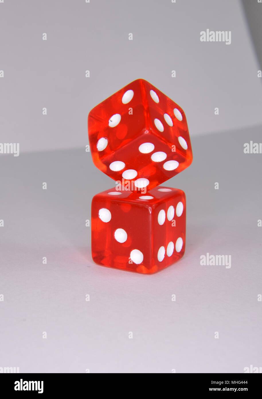 Stacked and balancing red luminescent casino gambling dice Stock Photo