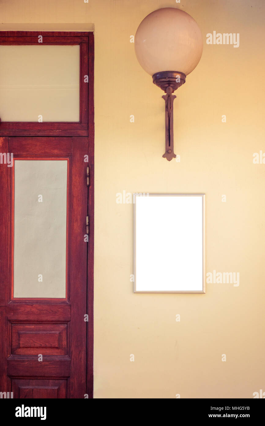 Mock up. Blank signboard on the wall near entrance to shop, store, restaurant or hotel. Stock Photo