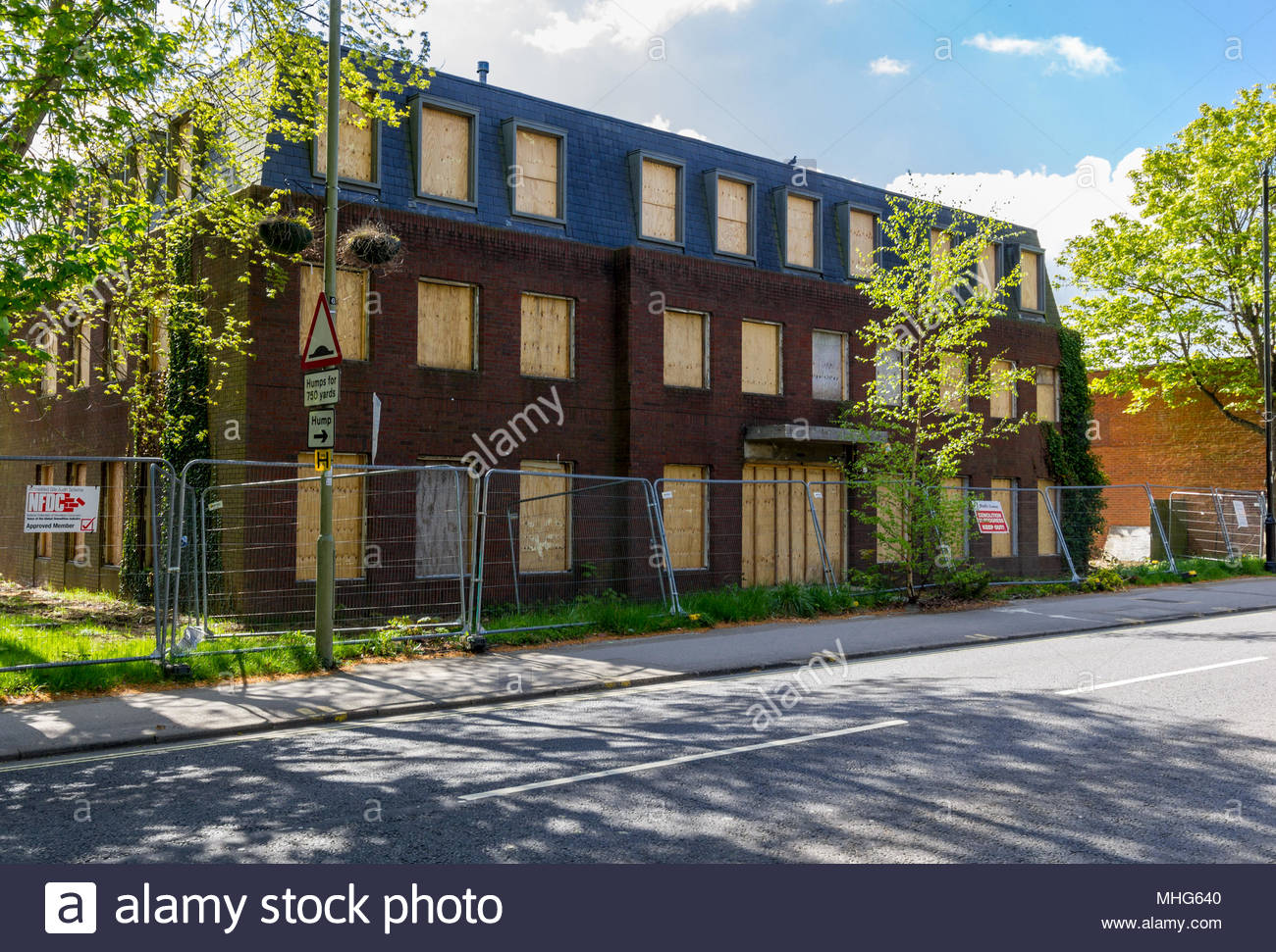 Urban regeneration, unused office block boarded up prior to change of use to residential accommodation. - Stock Image