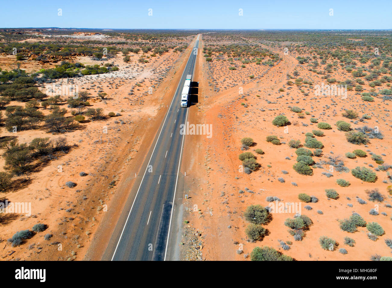 Road Train truck traveling on the great northern highway, Eastern Goldfields, Western Australia Stock Photo