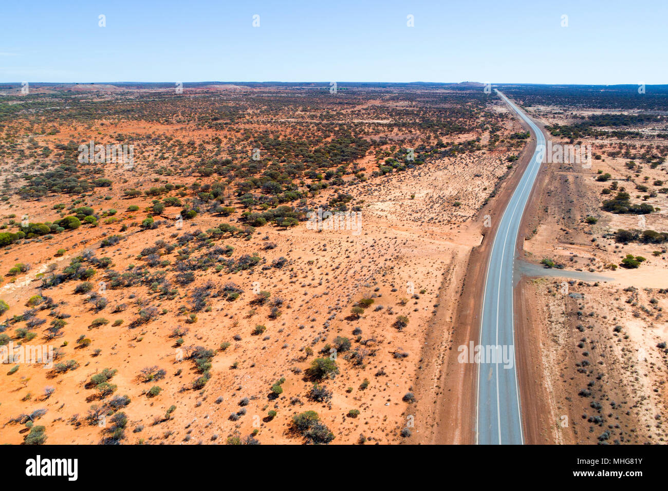 Aerial view of the great northern highway in red landscape, Eastern Goldfields, Western Australia Stock Photo