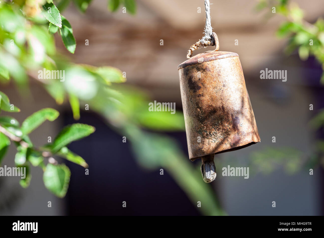 Ritual bell hanging on blurred background - Stock Image