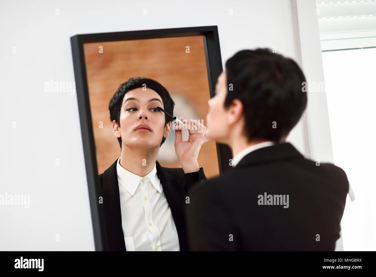 Woman Putting On Makeup In Stock Photos  Woman Putting On -2043