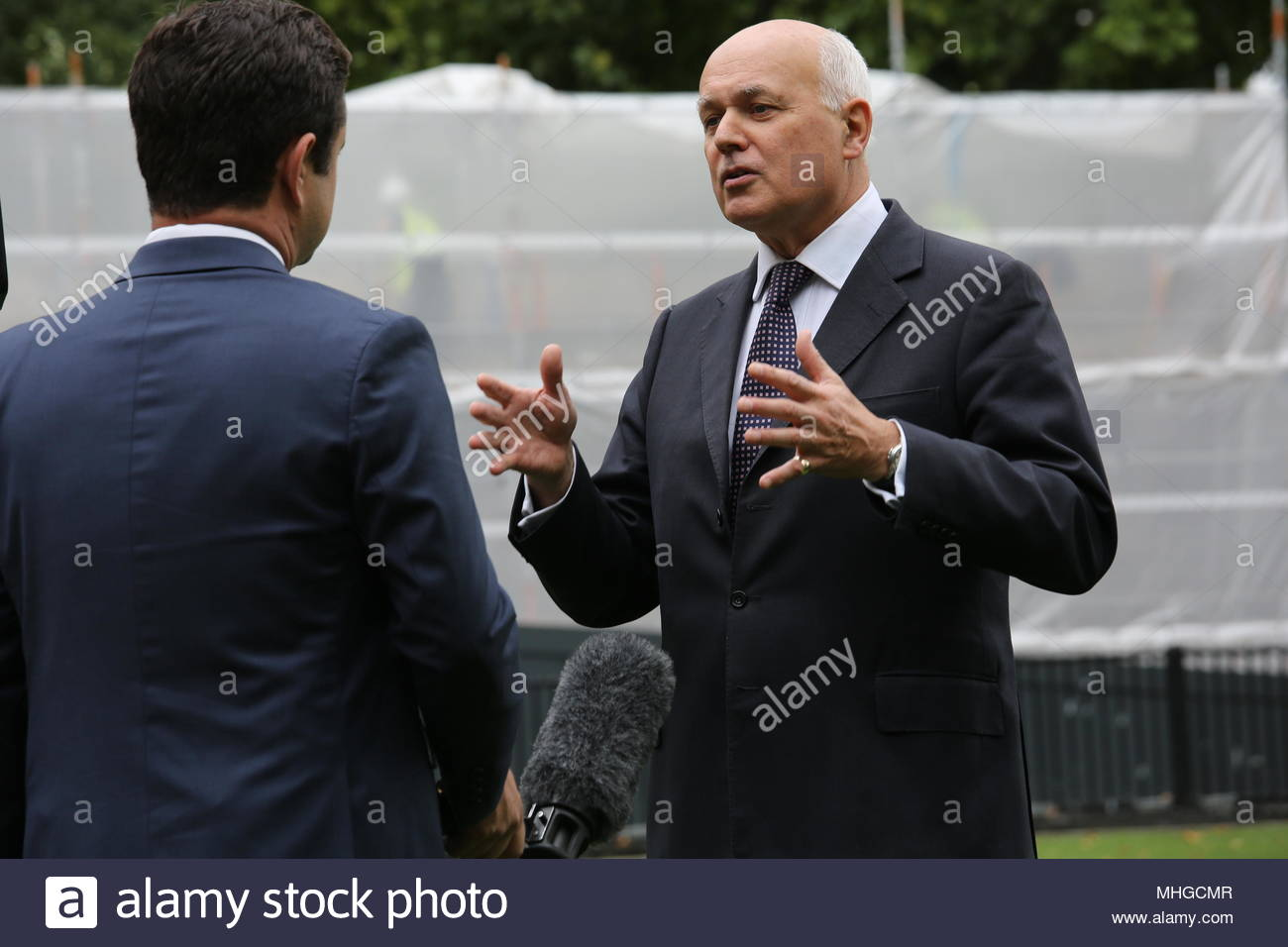 Iain Duncan Smith gives a TV interview at Westminster London - Stock Image