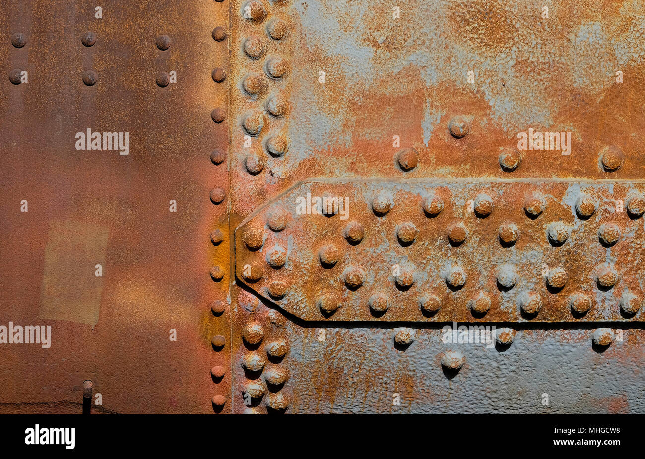 weathered sheet metal with rivets background - Stock Image
