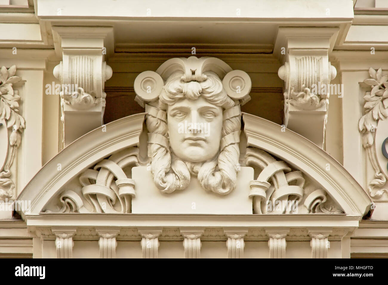 Art deco style decorations with sad man`s face - Stock Image