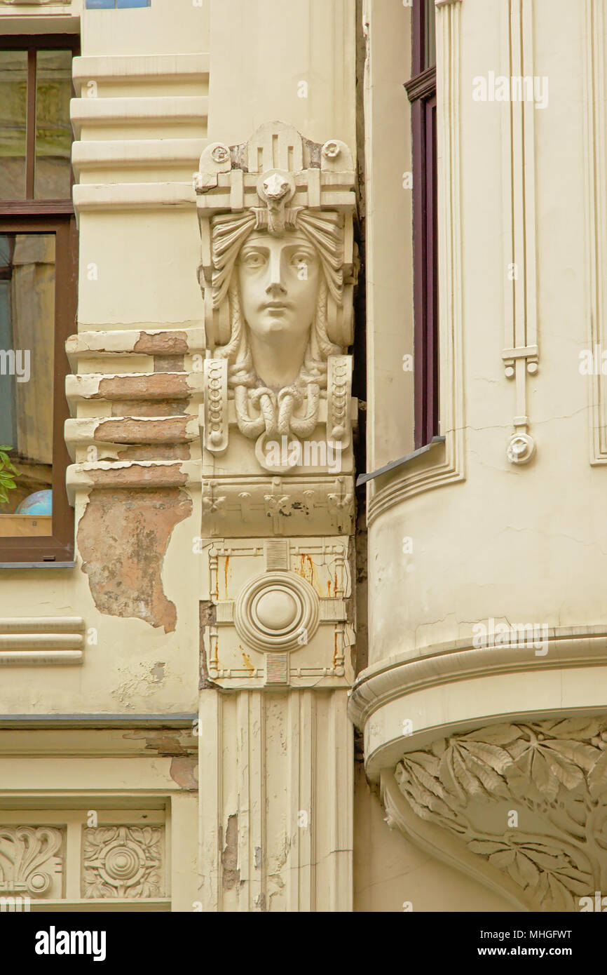 Art deco style decorations with man`s face, decoration of the face of a Jugendstil house, Riga, Latvia - Stock Image