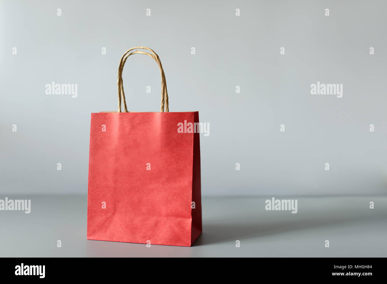Red shopping bags from recycle paper isolated on white background. Black friday or Christmas sales. - Stock Image