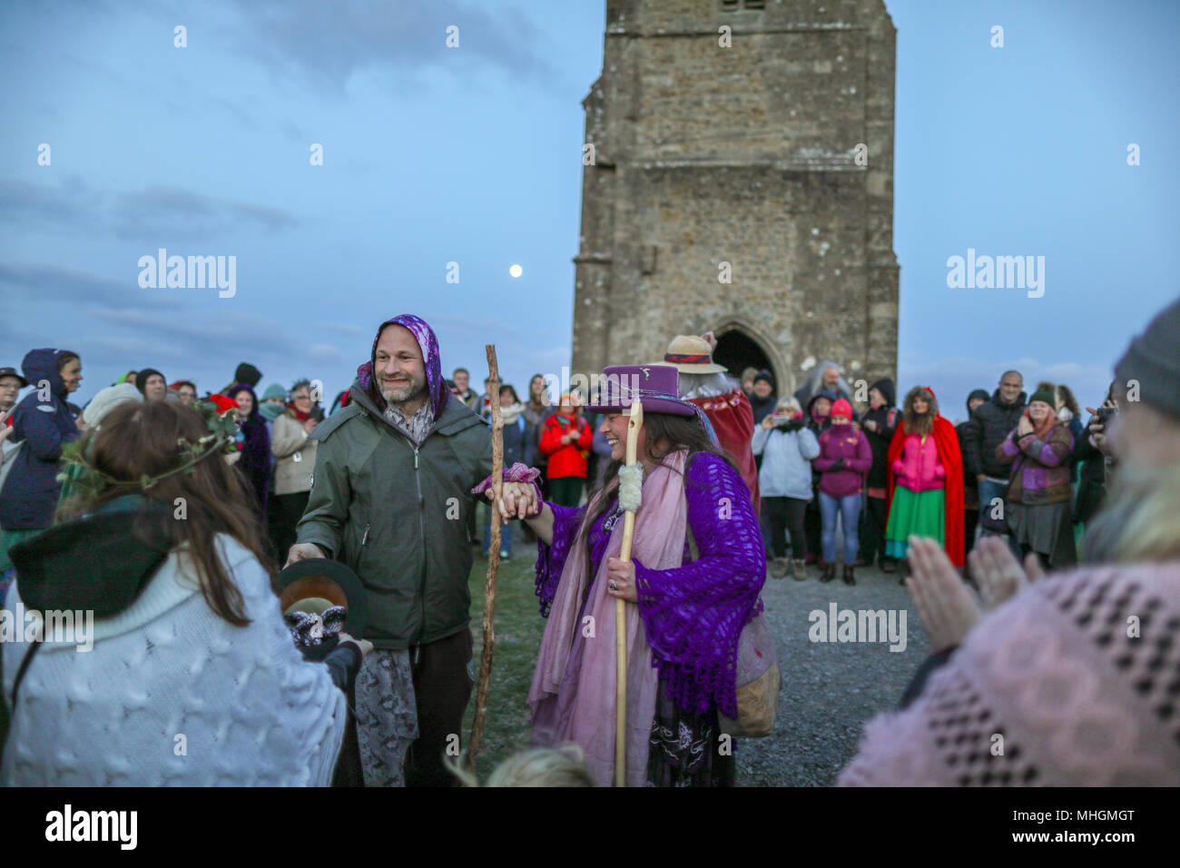 Glastonbury, UK. 1st May 2018. Beltane Celebrations at sunrise on Glastonbury Tor, Somerset, England.  Beltane is the ancient Celtic May Day, or spring festival celebrating the commencement of summer. © Haydn Denman/Alamy Live News - Stock Image