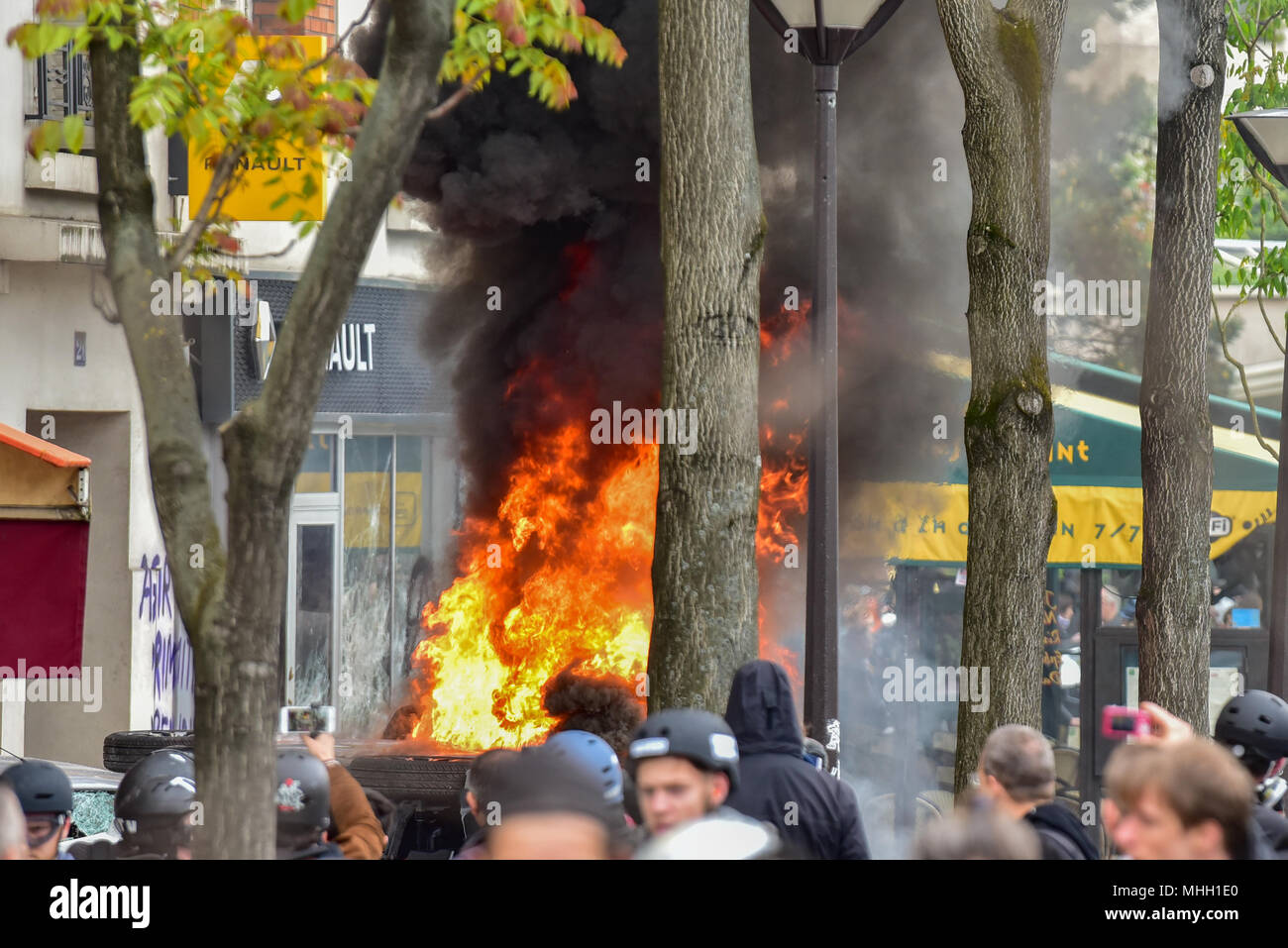 Paris, France. 1st May 2018. Paris police clash with protesters as demonstrations turn violent. PICTURED: 'Black Bloc' protesters smashed their way into a Renault car showroom and set a motorbike on fire. Credit: Peter Manning/Alamy Live News Stock Photo
