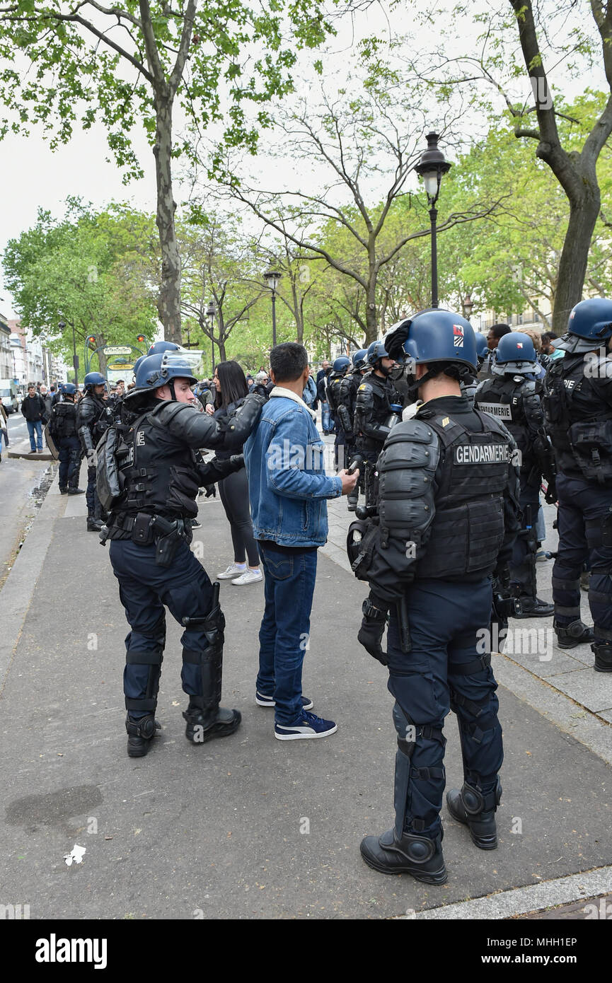 Paris, France. 1st May 2018. Paris police clash with protesters as demonstrations turn violent. PICTURED: suspected 'Black Bloc' protesters are detained and searched by police. Credit: Peter Manning/Alamy Live News - Stock Image