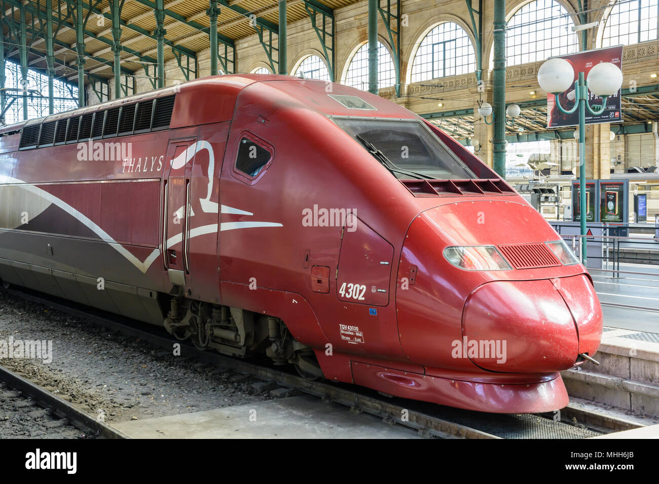 Locomotive of a Thalys high-speed train built by Alstom and run by european consortium Thalys International, stationed in Paris Gare du Nord station. - Stock Image